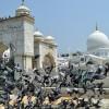 Pigeons flying around the entrance gate to Hazratbal Mosque, Srinagar-KV photo (June 11, 2018)
