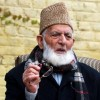 Syed Ali Geelani leaves for Sopore from fortified Hyderpora office, to visit daughter after son-in-law's demise